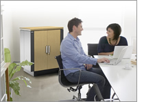 APC Netshelter CX quiet rack cabinets shown in office situation.